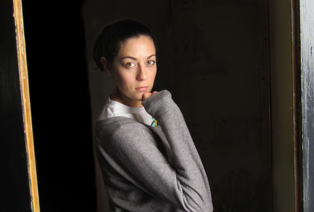 Girl with a grey sweatshirt